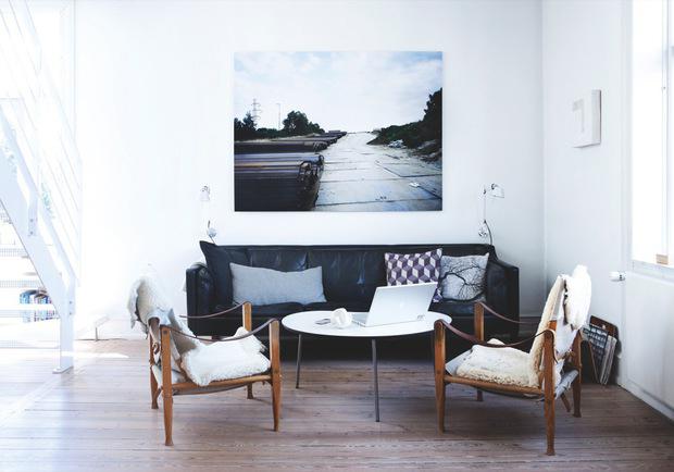 Home with a bookshelf wall - via Coco Lapine